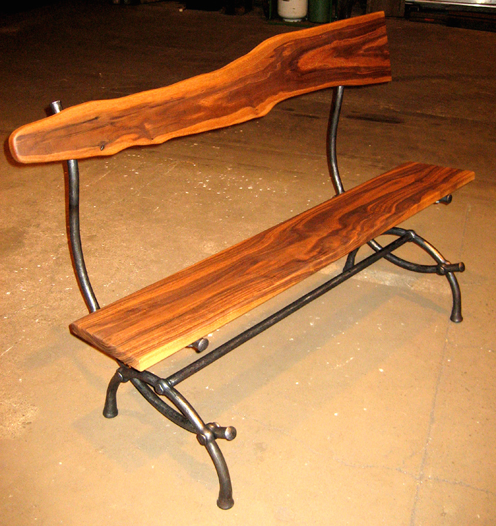 Black walnut bench with hand-forged iron